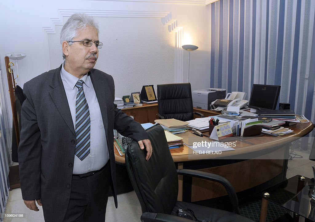 The dean of the Manouba Faculty of Arts, Letters, and Humanities, Habib Kazdaghli arrives to answer journalists' questions in his office on January 17, 2013, outside Tunis. Kazdaghli's trial, in which he is accused of slapping a female student wearing an Islamic veil, has been postponed by the court to March 28, 2013. AFP PHOTO / FETHI BELAID