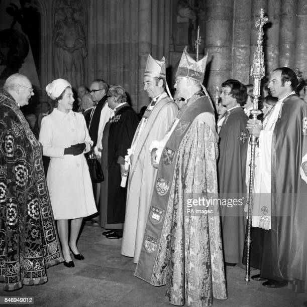 The Dean of Westminster the Ven Edward Carpenter left introduces Queen Elizabeth II to the Archbishop of York the Most Rev Stuart Blanch second right...