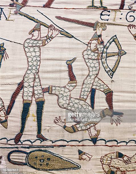 The death of Lewine and Gyrd brothers of King Harold detail from the Bayeux tapestry or the Tapestry of Queen Matilda France 11th century Bayeux...