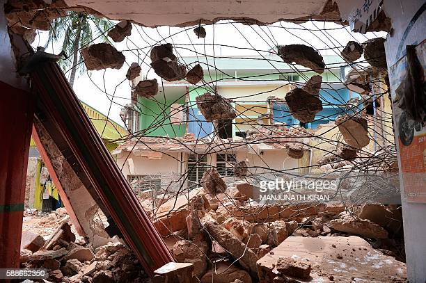 The debris of demolished houses is seen a day after Bangalore's municipal authority Bruhat Bengaluru Mahanagara Palike brought down houses and...