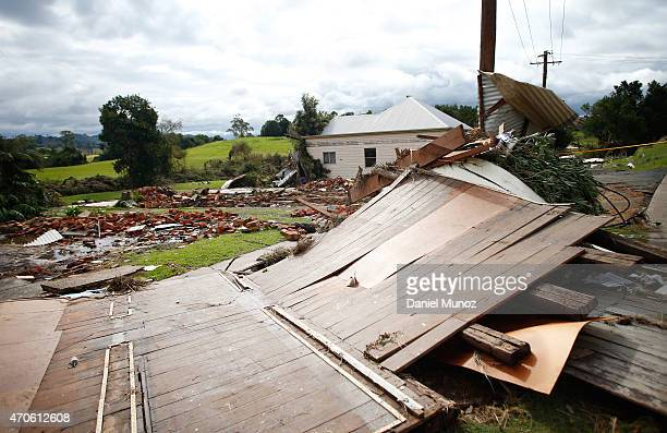 The debris of houses destroyed by cyclonic winds are seen on April 22 2015 in Dungog Australia Three people have died and more than 200000 are still...