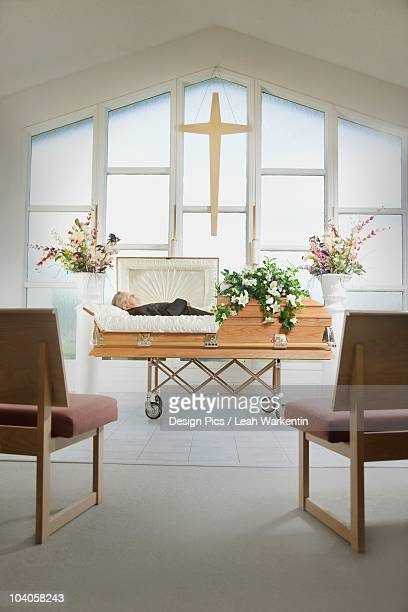 The Deceased Laying In A Coffin At A Funeral Home