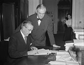 The Declaration of War against Japan asked by President Roosevelt only a few short minutes before and passed by the Senate 820 is signed for the...