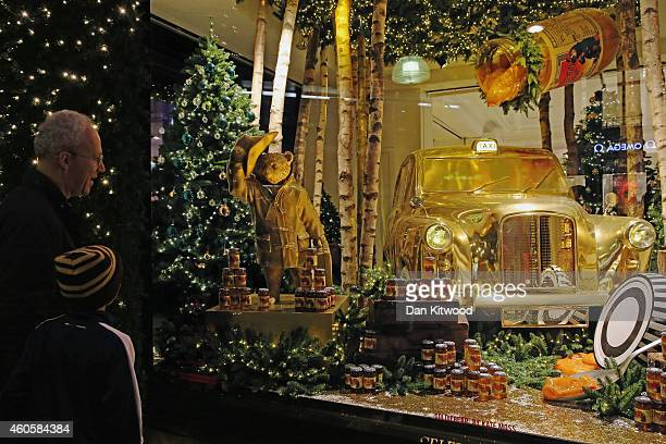 The decorated Christmas shop windows of Selfridges on Oxford Street on December 15 2014 in London England Many prominent retailers in the capital...