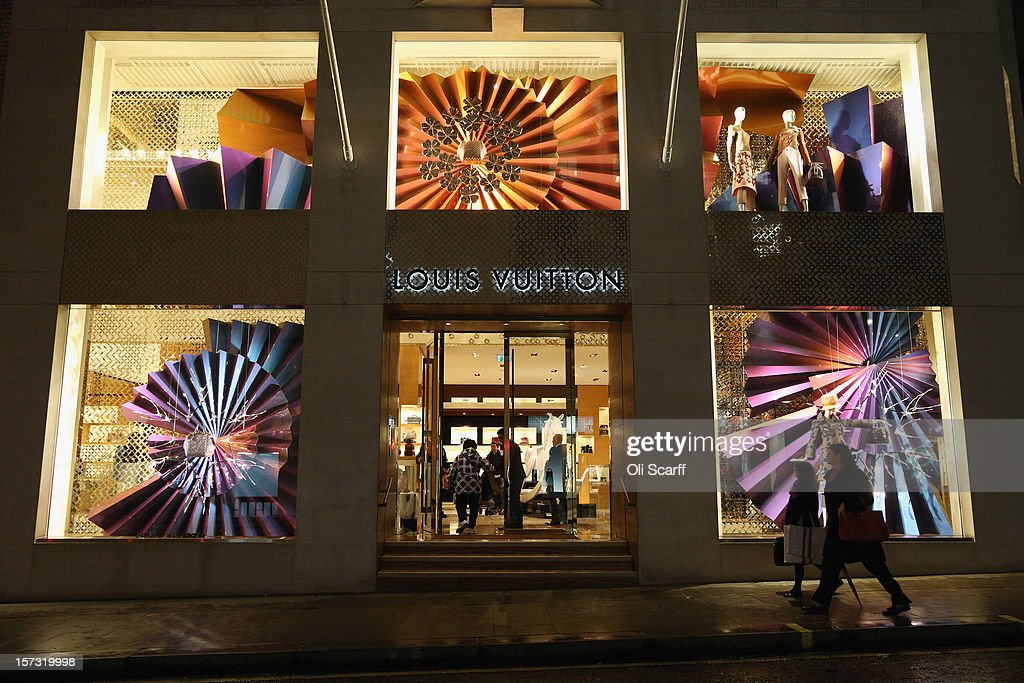The decorated Christmas shopfront of the Louis Vuitton store on Bond Street on November 26, 2012 in London, England. Many prominent retailers in the capital have produced elaborate festive window displays to entice Christmas shoppers with less than one calendar month remaining before Christmas Day.