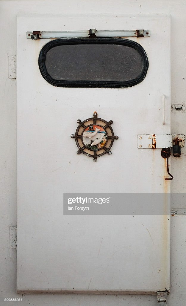 The decorated door of the wheel house of a fishing boat is seen on February 10, 2016 in Redcar, England. The inshore fishing fleet at Redcar originated in the early 14th Century with crab, lobster and fishing bringing in much needed income to local fishermen. As the fishing industry has steadily declined so to the fleet has reduced in size so that today only a small number of boats still put to sea from the town to continue the fishing heritage on the east coast of England.