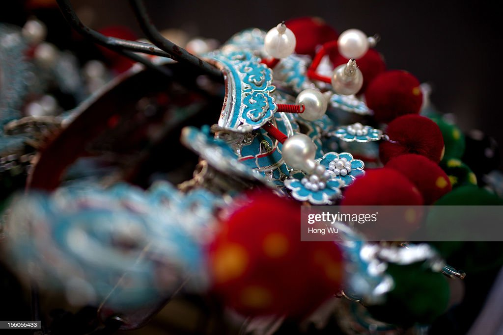 The decorations of Chinese Yu Opera performers are seen backstage on October 30, 2012 in Zhengzhou, China. As many as 60 performers from the Sanmenxia theatrical troupe are invited to perform Chinese traditional Yu Opera for local villagers in rural Zhengzhou city to celebrate the village's temple fair and earn 10,000 RMB yuan (US$ 1,600) each performance. Yu Opera, also called Henan Bangzi or Ou Opera, is one of the most popular local operas in China. Its earliest written record can be traced back more than 200 years and at the end of the Qing Dynasty (A.D. 1644-1911), the opera became widespread across the Henan province. After the establishment of the People's Republic of China in 1949, it experienced rapid growth not only in the villages and cities of Henan Province but also throughout the country. In recent years its popularity has declined due to young people's attraction to more modern cultures.
