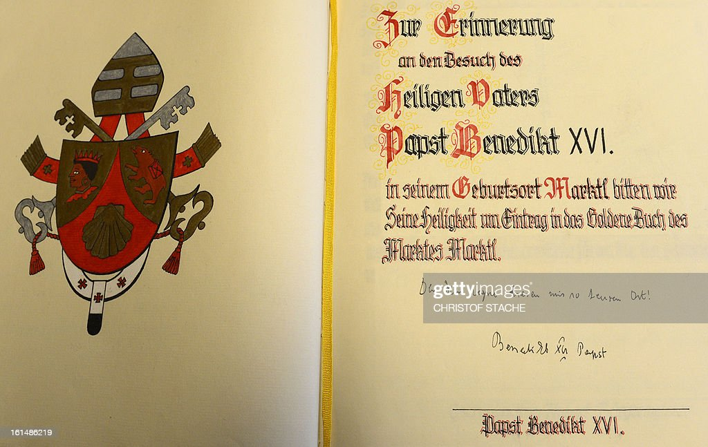 The dedication of Pope Benedict XVI is pictured in the golden book of his birthplace town the Bavarian village Marktl, southern Germany, on February 11, 2013, during his visit in 2006. The Pope announced he will resign on February 28, a Vatican spokesman told AFP, which will make him the first pope to do so in centuries.