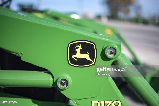 The Deere Co John Deere logo is seen on a tractor at a United Ag Turf dealership in Waco Texas US on Monday Nov 20 2017 Deere Co is scheduled to...
