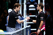 The defeated Andy Murray of Great Britain shakes hands with Stan Wawrinka of Switzerland following the men's singles match on day six of the Barclays...