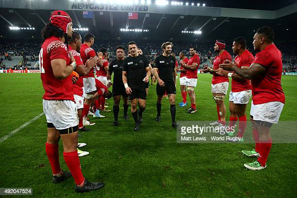 The defeated Tonga team applaud the New Zealand All Blacks as they leave the pitch after the 2015 Rugby World Cup Pool C match between New Zealand...