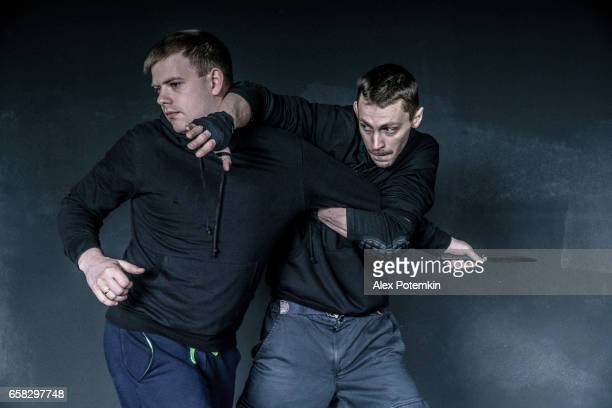 The defense against the knife attack. Krav Maga practice: the self-defense martial art developed for the Israel Army. Minsk, Belarus.
