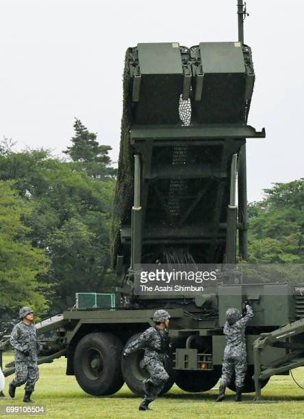 The Defense Ministry displays Patriot Advanced Capability 3 surfacetoair guided missile units at the SelfDefense Forces' Camp Asaka on June 21 2017...