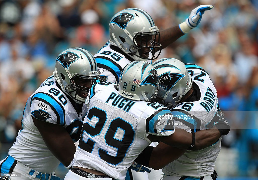 The defense of the Carolina Panthers celebrates after a stop against the Jacksonville Jaguars during their game at Bank of America Stadium on September 25, 2011 in Charlotte, North Carolina.