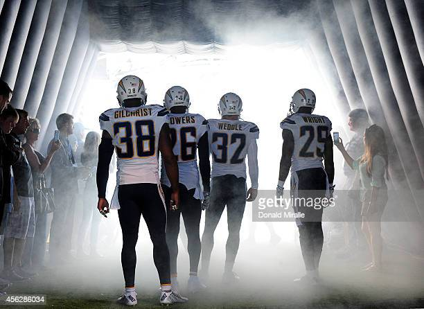 The defensive starters of the San Diego Chargers wait to enter the field before an NFL game against the Jacksonville Jaguars at Qualcomm Stadium on...
