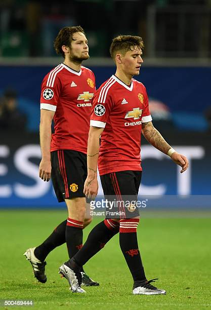 The dejected Daley Blind and Guillermo Varela of Manchester United walk off the pitch following their team's 32 defeat and exit from the competition...