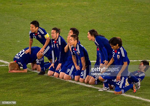 The dejected Japan team react after Oscar Cardozo of Paraguay scored this winning penalty kick in the shoot out