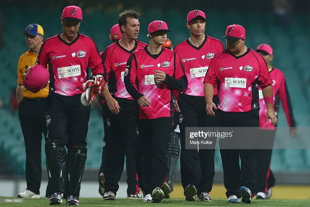 The dejected Sixers team leave the field after losing during the Big Bash League match between the Sydney Sixers and the Perth Scorchers at SCG on December 16, 2012 in Sydney, Australia.