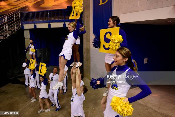 The Delaware Fightin Blue Hens cheerleaders warmup as the men's basketball team hosts the William Mary Tribe at the Bob Carpenter Center on February...
