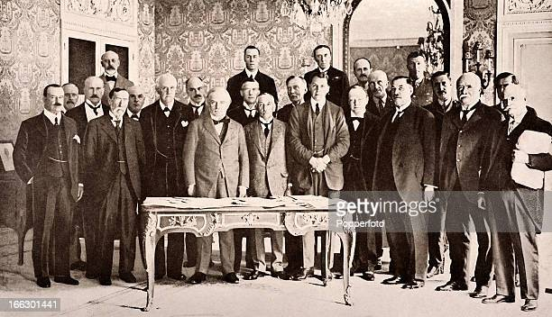 The delegates representing the British Empire being entertained by Mr Lloyd George at his residence 23 Rue Nitot Paris during the meetings following...