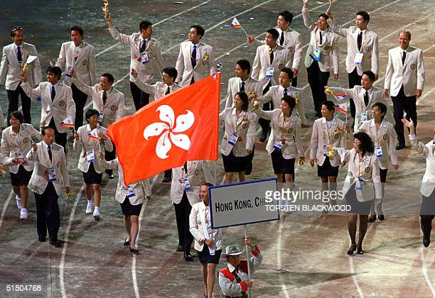 The delegation from Hong Kong China parades during the opening ceremony of the 2000 Summer Olympics in Sydney 15 September 2000 AFP PHOTO/Torsten...