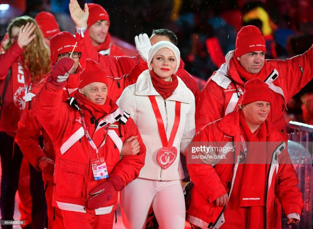 The delegation of Monaco and Princess Charlene of Monaco arrive at the Opening ceremony of the 'Special Olympics World Wintergames 2017' in Schladming, Austria, om March 18, 2017. / AFP PHOTO / APA / BARBARA GINDL / Austria OUT