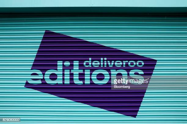 The Deliveroo Editions logo sits on the metal shutters of their field kitchen operated by Roofoods Ltd in Hove UK on Wednesday Aug 9 2017 Deliveroo...