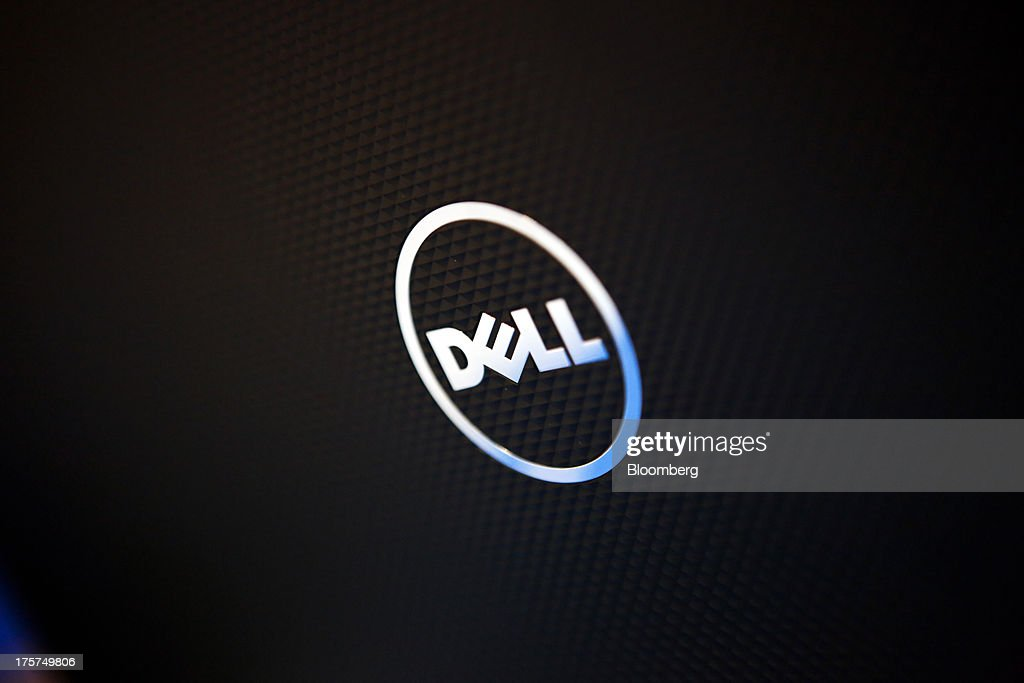 The Dell Inc. logo is seen on the back of an Inspiron 15 laptop during an event at a Curacao Department store in Los Angeles, California, U.S., on Wednesday, August 7, 2013. The Inspiron 15, an affordable notebook with an impressive battery life, is the only Spanish-language laptop manufactured and sold in the U.S. offered by Dell. Photographer: Patrick T. Fallon/Bloomberg via Getty Images