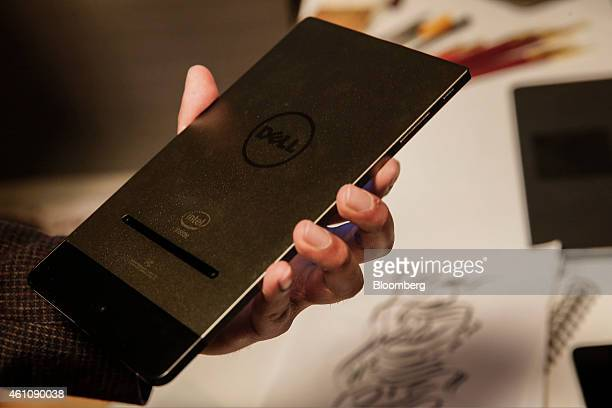 The Dell Inc Venue 8 7000 series tablet computer is displayed for a photograph during the 2015 Consumer Electronics Show in Las Vegas Nevada US on...