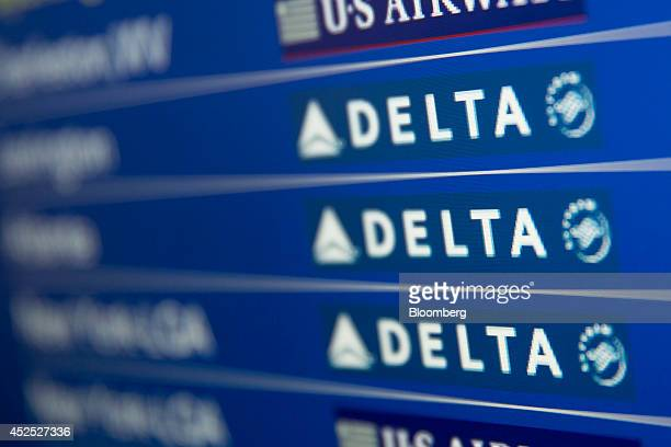 The Delta Air Lines Inc logo is seen on the departures and arrivals screen at Ronald Reagan National Airport in Washington DC US on Friday July 18...