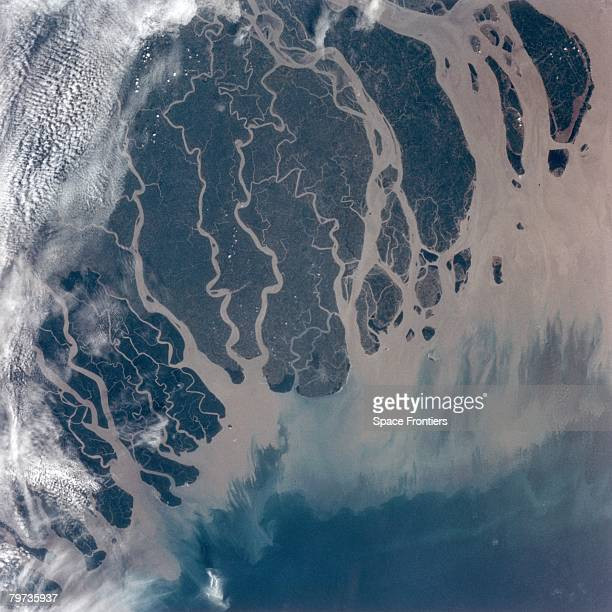 The delta of the River Ganges empties into the Bay of Bengal in Bangladesh as seen from the space shuttle Atlantis during NASA's STS66 mission...