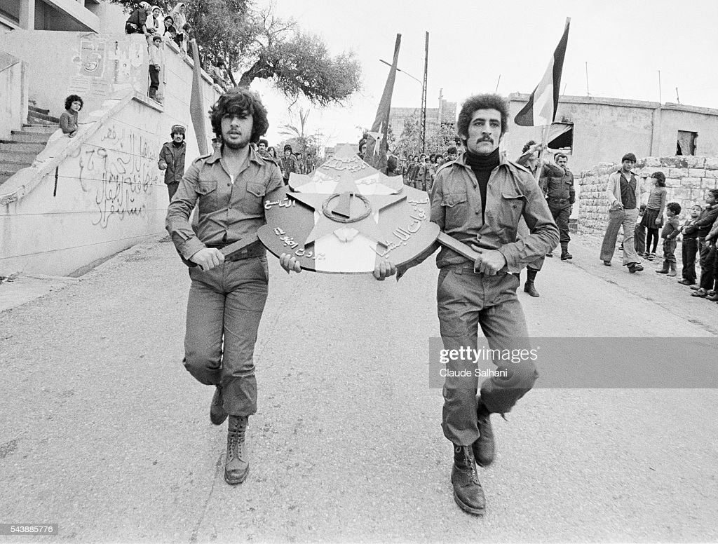 The Democratic Front for the Liberation of Palestine celebrates its 9th anniversary with a military parade and rally