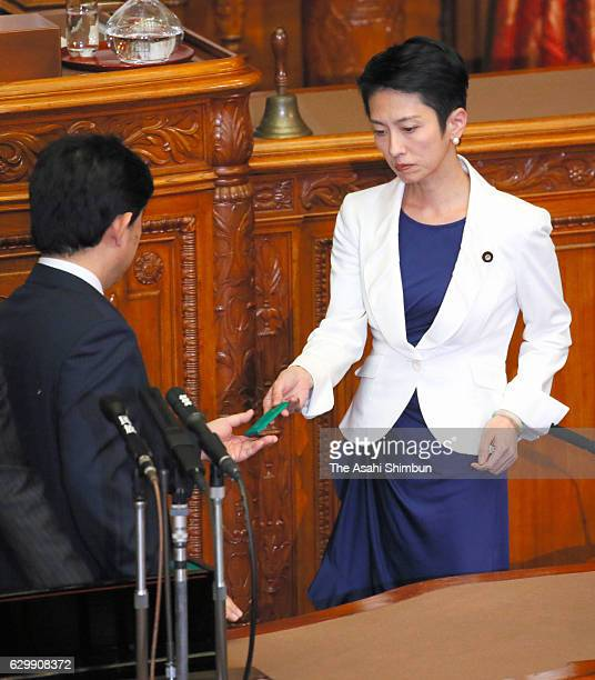 The Democratic Party President Renho votes against the bill at the plenary session of the Upper House at the diet building on December 14 2016 in...