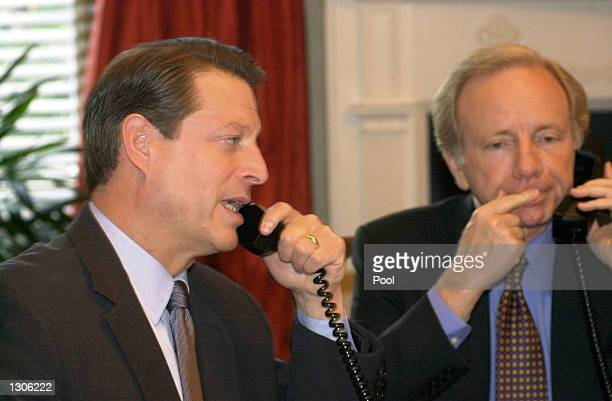The Democratic presidential candidate US Vice President Al Gore left and his running mate US Senator Joe Lieberman speak via conference call with...