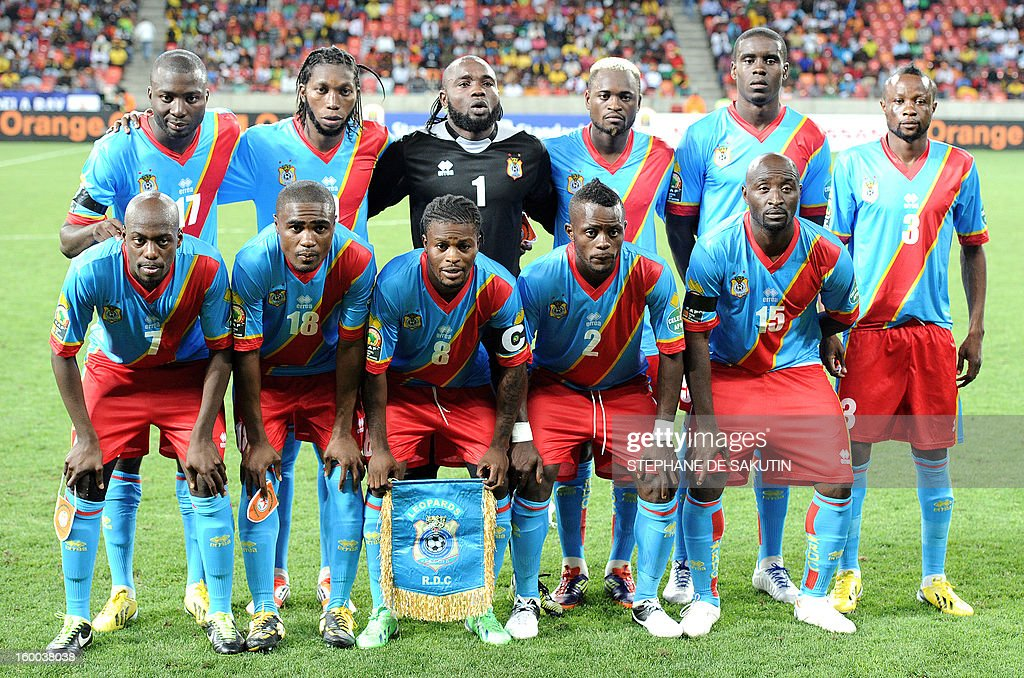 The Democratic Republic of Congo's team players pose on January 24, 2013 before a 2013 African Cup of Nation Group B football match against Niger at Nelson Mandela Bay Stadium in Port Elizabeth. Front row, from left : midfielder Youssouf Mulumbu, midfielder Cedric Makiadi, midfielderTresor Mputu, defender Mpeko Issama, forward Lomana Lua Lua. Back row, from left : defender Cedric Mongongu, forward Dieudonne Mbokani, goalkeeper Robert Kidiaba, unidentified player, unidentified player, defender Jean Kasusula.