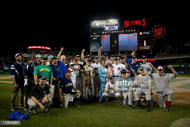 The Democrats pose for a photo after winning the 52nd annual Congressional Baseball Game at National Stadium in Washington on Thursday June 13 2013