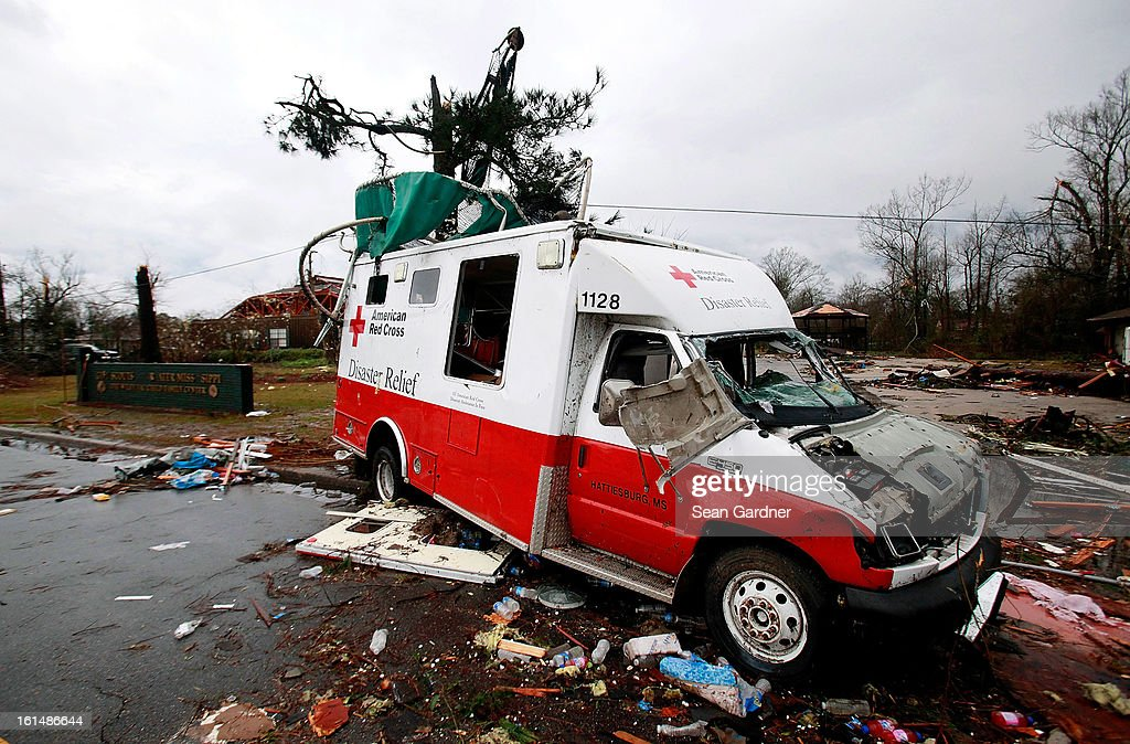 The demolished remains of an American Red Cross truck is seen on the street after a tornado touched down yesterday evening February 11, 2013 in Hattiesburg, Mississippi. Hundreds of homes were destroyed and over sixty people injured when the tornado ripped through the town.
