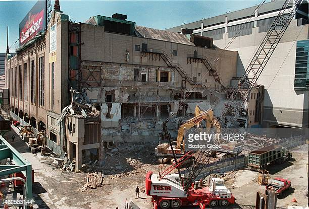 The demolition of the old Boston Garden was in full force Saturday as crews gingerly knocked down portions of the east wall which used to connect to...
