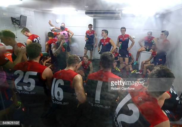 The Demons are seen in the cool room during the quarter time break during the round 16 AFL match between the Melbourne Demons and the Fremantle...