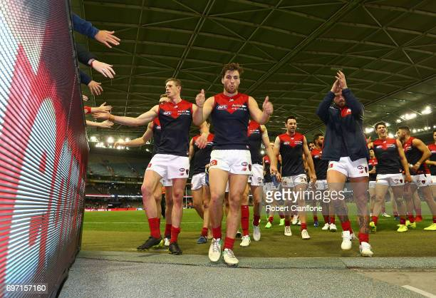 The Demons celebrate after they defeated the Bulldogs during the round 13 AFL match between the Western Bulldogs and the Melbourne Demons at Etihad...