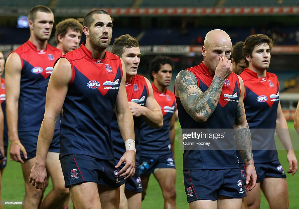 The Demons look dejected after losing the round seven AFL match between the Melbourne Demons and the Gold Coast Suns at Melbourne Cricket Ground on May 12, 2013 in Melbourne, Australia.