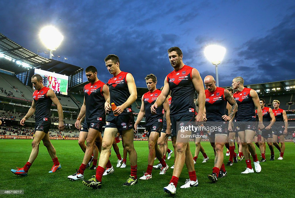 The Demons look dejected as they leave the field after losing the round five AFL match between the Melbourne Demons and the Gold Coast Suns at Melbourne Cricket Ground on April 20, 2014 in Melbourne, Australia.