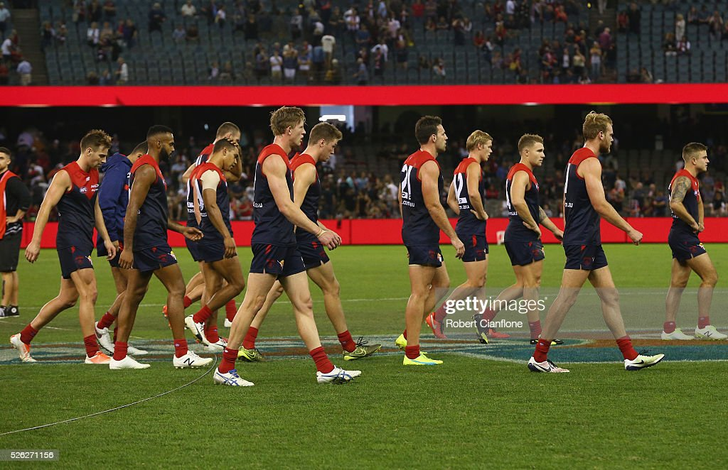 The Demons walk from the ground after they were defeated by the Saints during the round six AFL match between the Melbourne Demons and the St Kilda Saints at Etihad Stadium on April 30, 2016 in Melbourne, Australia.