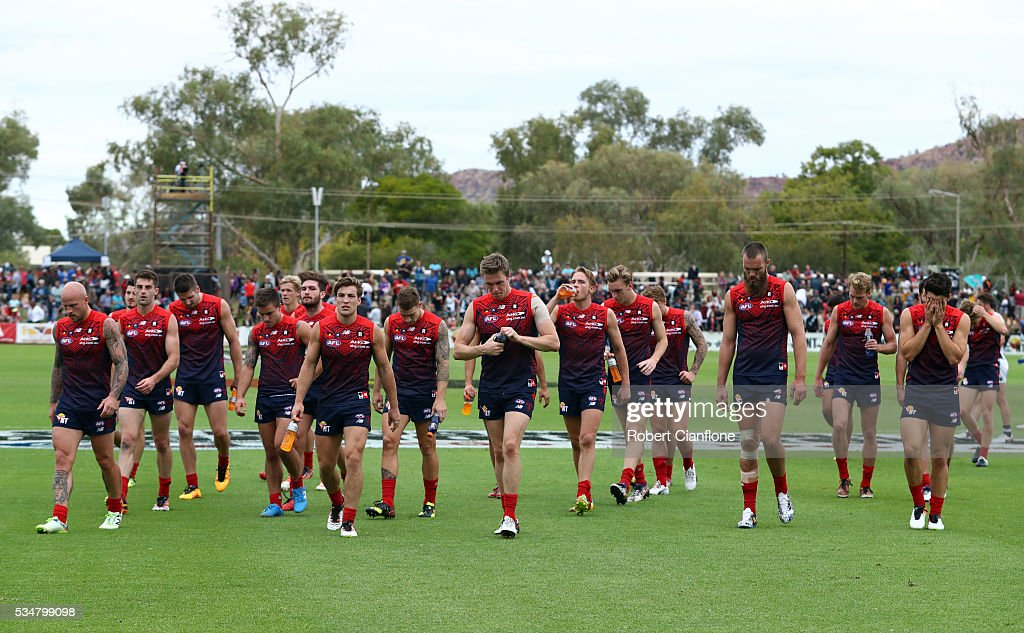 The Demons walk off the ground after they were defeted by the Power during the round 10 AFL match between the Melbourne Demons and the Port Adelaide Power at Traeger Park on May 28, 2016 in Alice Springs, Australia.