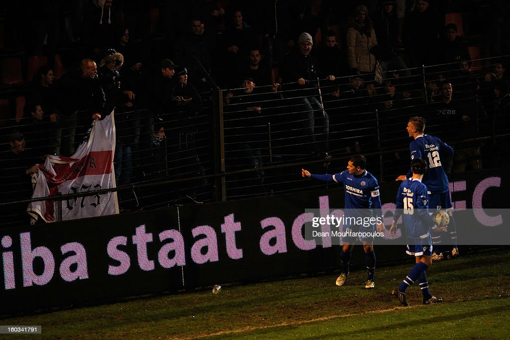 The Den Bosch players tell the fans to calm down as play is stopped during the KNVB Dutch Cup match between FC Den Bosch and AZ Alkmaar at BrainWash Stadion De Vliert on January 29, 2013 in Bosch, Netherlands.