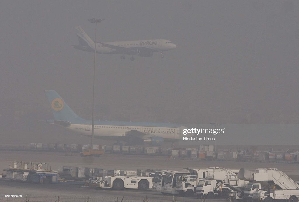 The dence fog and cold at Indira Gandhi International Airporton December 28, 2012 in New Delhi, India. While the maximum temperature was recorded at 19 deg C, up from yesterday's temperature by 2.4 degrees, the minimum temperature today dipped to 6.3 deg C, a degree below the normal.