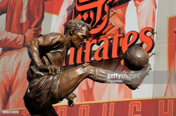 The Dennis Bergkamp statue is unveiled outside the stadium before the match between Arsenal and Sunderland in the Barclays Premier League at the...