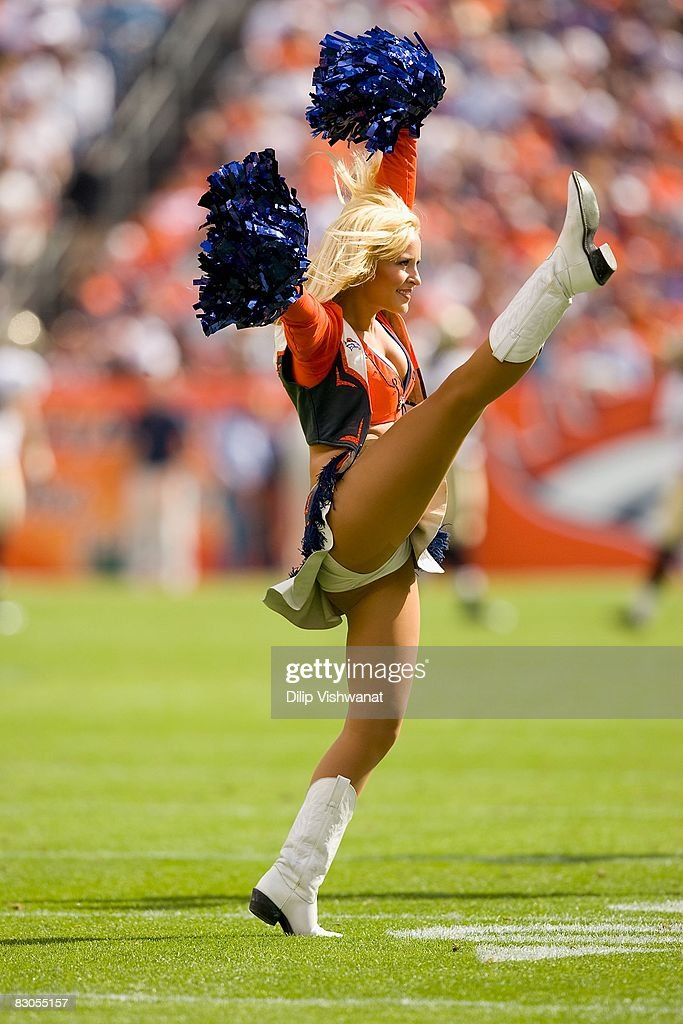 The Denver Broncos cheerleaders perform on the field against the New Orleans Saints at Invesco Field at Mile High on September 21, 2008 in Denver, Colorado. The Broncos beat the Saints 34-32.