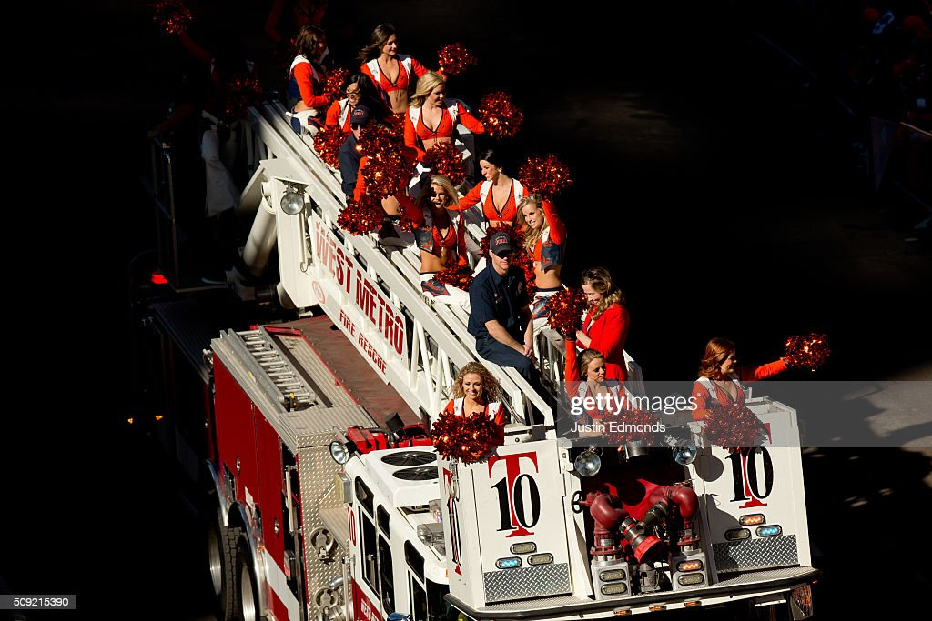 The Denver Broncos cheerleaders pump up the crowd from a fire truck during a victory parade to celebrate their Super Bowl championship on February 9, 2016 in Denver, Colorado. The Broncos defeated the Panthers 24-10 in Super Bowl 50.