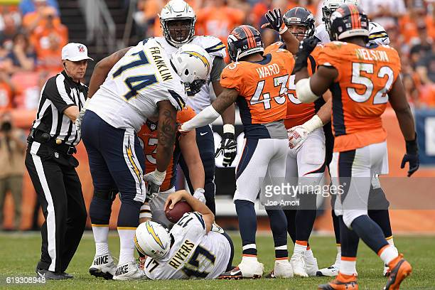 The Denver Broncos defense celebrates after Jared Crick and Derek Wolfe bring down Philip Rivers of the San Diego Chargers during the second quarter...